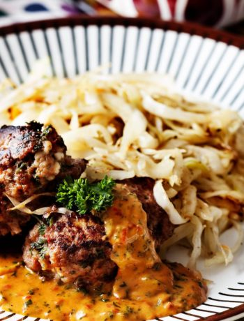 Hamburger Patties with Creamy Tomato Sauce and Fried Cabbage